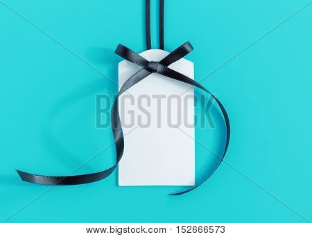 Tag With Ribbon On Blue
