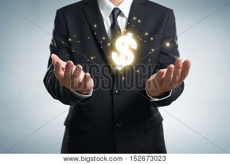 Business man , holding dollar symbol .