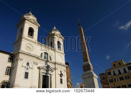 Twin bell towers of Trinità dei Monti with ancient egyptian obelisk at the top of famous Spanish Steps in the center of Rome