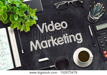 Video Marketing Handwritten on Black Chalkboard. Top View Composition with Black Chalkboard with Office Supplies Around. 3d Rendering. Toned Illustration.