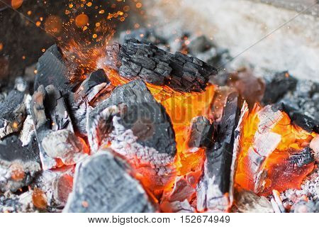 Burning Charcoal Close Up. Hot Charcoal Glowing Briquettes.