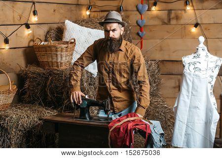 Tailor Man Near Sewing Machine