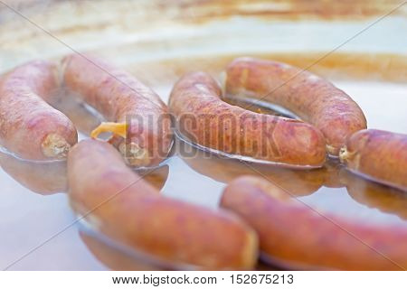 Chorizo Sausages Slowly Cooked in Huge Pan