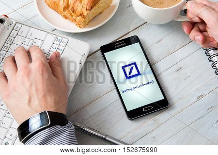 WROCLAW POLAND - OCTOBER 14th 2016: Samsung A5 with Deutsche Bank application laying on desk. Deutsche Bank is a German global banking and financial services company with its headquarters in Frankfurt.