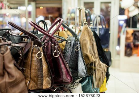 Shelf with fashion bags in a store