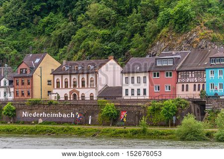 Niederheimbach Germany - May 23 2016: Niederheimbach village in the Unesco World Heritage area of the Rhine Valley in cloudy weather.