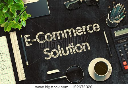 Top View of Office Desk with Stationery and Black Chalkboard with Business Concept - E-Commerce Solution. 3d Rendering. Toned Illustration.