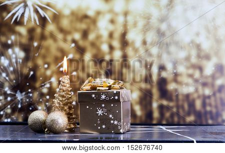 golden Christmas decorations and gift box on sparkling background
