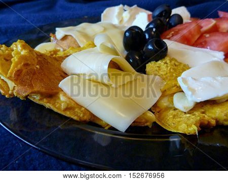 Pancakes With Cheese Olives And Tomato