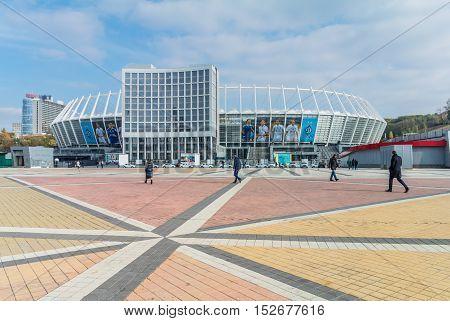 Kyiv Ukraine - October 20 2016: Pedestrians in front of the Olympic Stadium (NSC Olimpiysky) in Kyiv Ukraine.