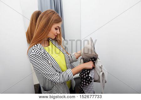 Woman stealing a dress