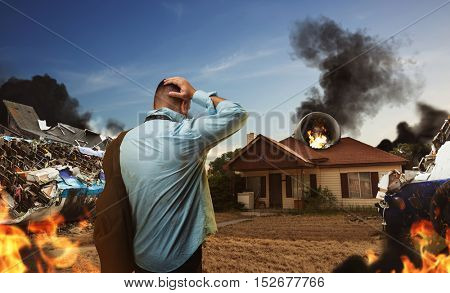 Man looking at the house after plane crash