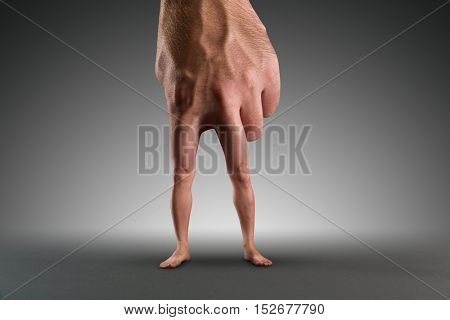 Male hand with legs