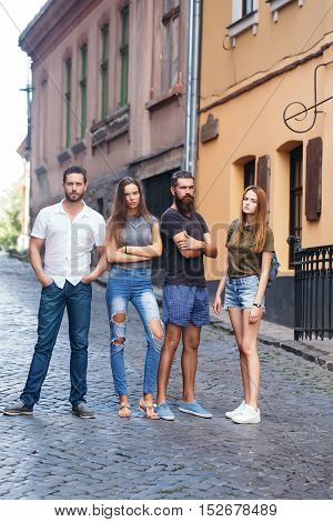 Four Friends Standing On Street