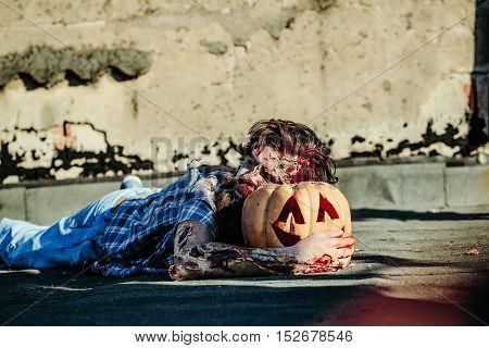 Zombie Man Sleeps On Pumpkin