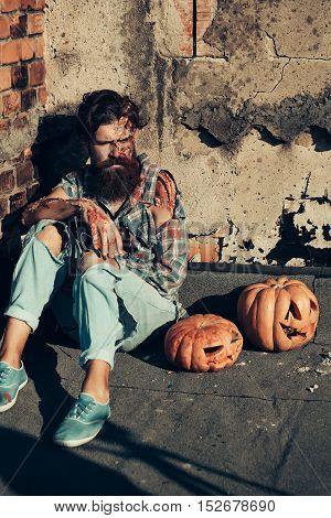 Zombie Man With Halloween Pumpkins