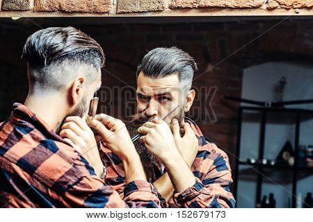 Man With Razor Near Mirror