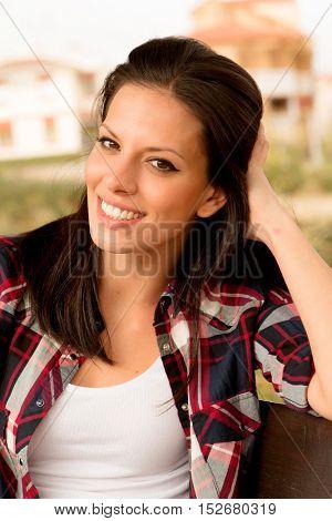 Pretty brunette woman in autumn outside
