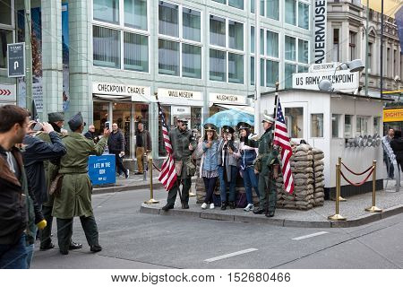Berlin Germany - October 07 2016: Former Checkpoint Charlie the city center border crossing between West and East Berlin Germany Europe. With American flag