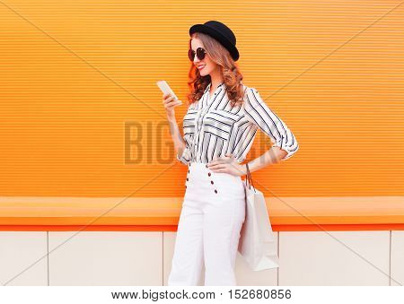 Fashion Pretty Happy Young Smiling Woman Model Using Smartphone With Shopping Bags Wearing A Black H