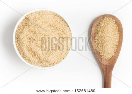 Demerara Sugar into a bowl isolated in white background