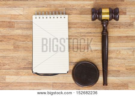Wooden Law Gavel, empty notebook on wooden table