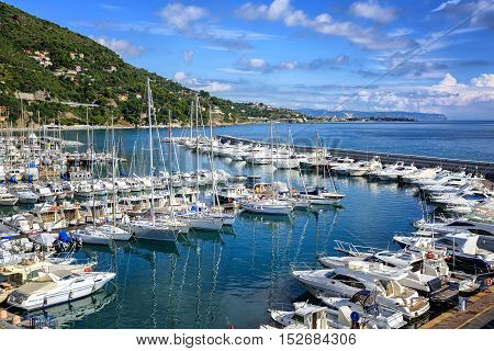 White yachts docked in mediterranean port of Alassio on italian Riviera Liguria Italy