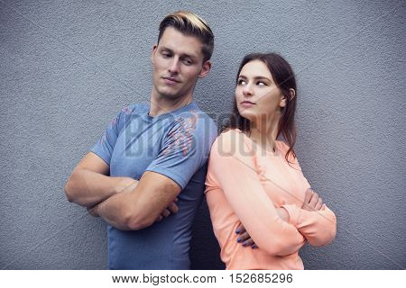 portrait of young sporty couple looking at each other