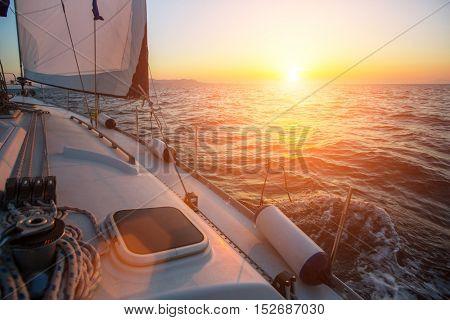 Sailing yacht against amazing sunset. Luxury yachts.