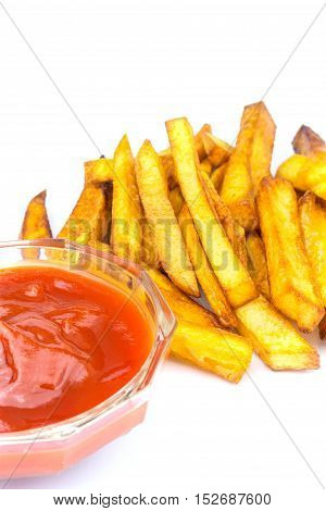 Homemade fast food portion of french fries and ketchup isolated on white background