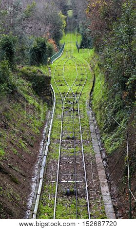 Landscape with narrow gauge railway track in Italy