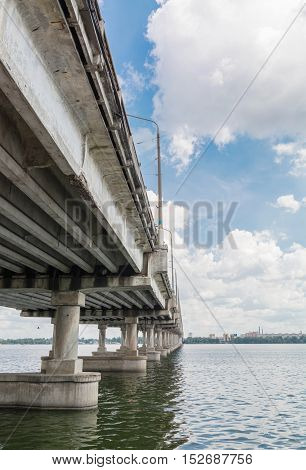 A long concrete bridge across the Dnieper River. Ukraine.