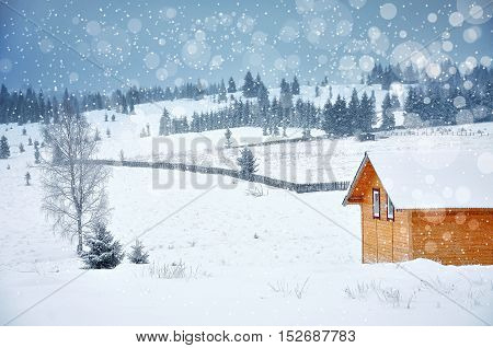 Christmas Winter Landscape With A Small Wooden Hut In The Mountains