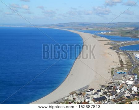 View from Portland over the village of Chesil along Chesil Beach a 29 km long shingle beach Dorset England UK