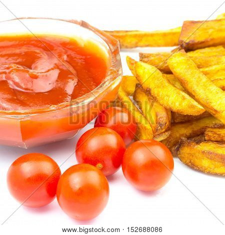 Homemade fast food portion of french fries ketchup and cherry tomato isolated on white background