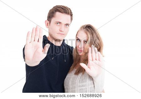 Handsome Couple Posing And Showing Stop Gesture