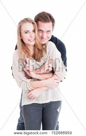 Attractive Couple Hoping Or Wishing With Fingers Crossed