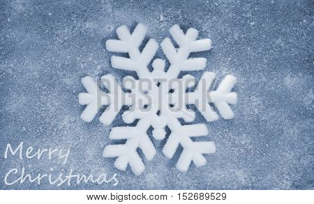 Snowflake, grey fiber fabric, blue glitter film and the words Merry Christmas