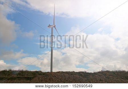 windmill against cloudy sky. A close up