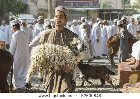 Nizwa Oman October 13th 2016: omani men at the cattle and goat market