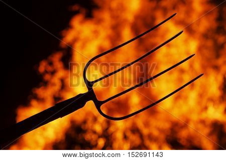 hell fork on the background of fire, Halloween. symbol hell, mysticism