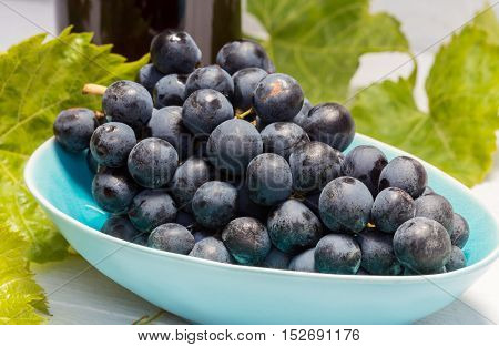 Grapes In A Bowl With Grape Leaves
