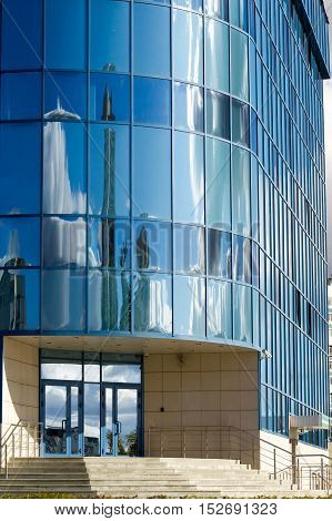 Texture, Pattern, Background. Reflection In Building Windows. Blue Windows, Clouds Reflected In The