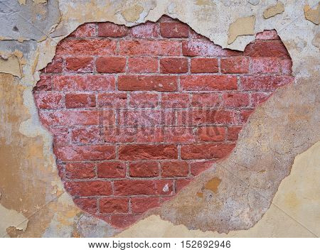 Old concrete and bricks wall with cracks