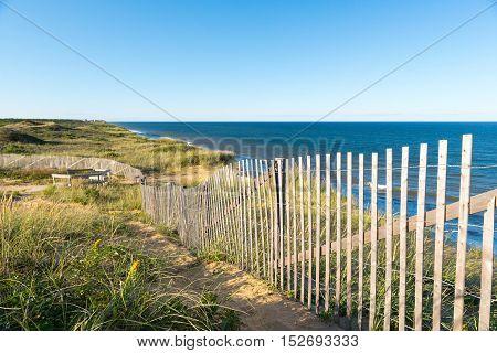 Fence on sand dune near the Atlantic ocean Cape Cod USA