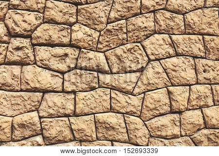 Horizontal textured background of ancient like stone wall.