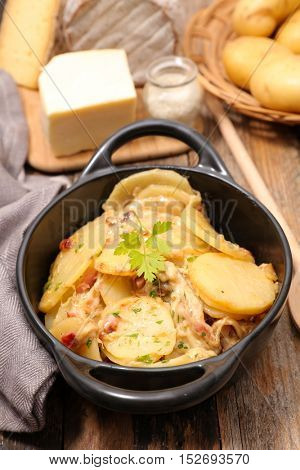 baked potato and bacon with cheese