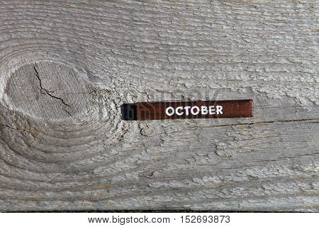 Wooden Cube With The Name Of The Month At The Old Board. October