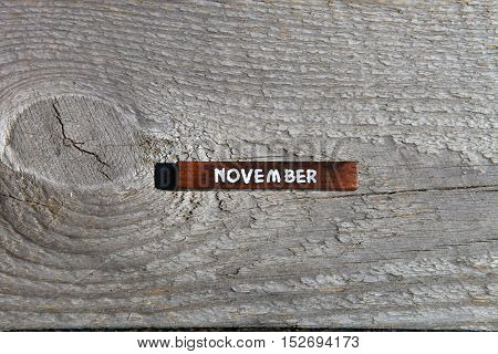 Wooden Cube With The Name Of The Month At The Old Board. November