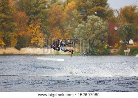 Kiyv Ukraine - October 02 2016: The training of kite surfers on the lake in autumn city